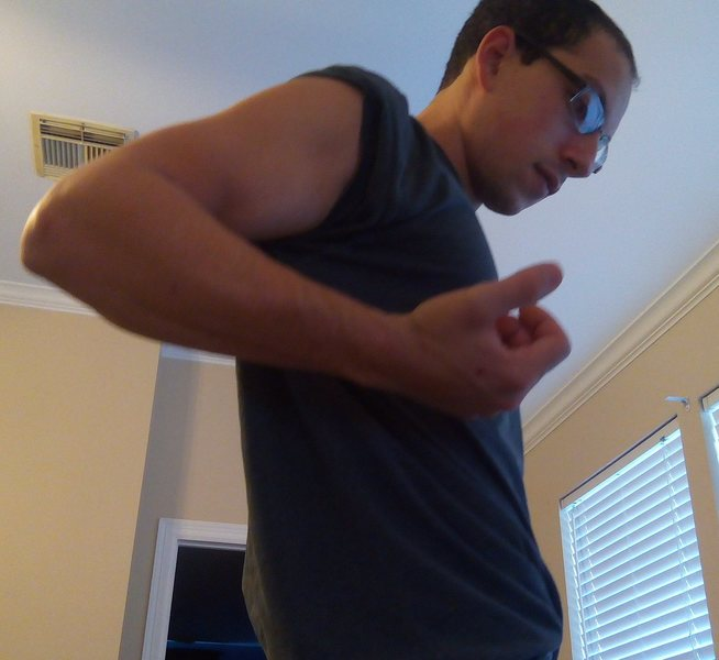 Standing up and pulling arm back