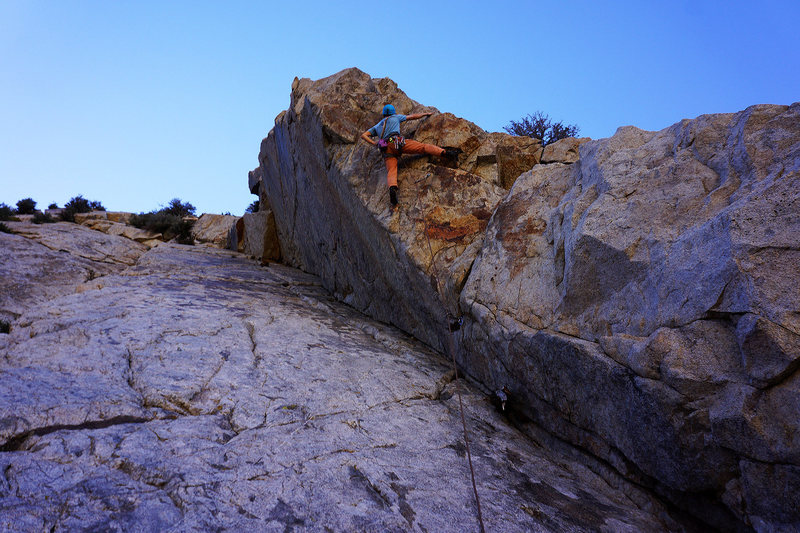 Starting the crux section of 'Funkytown'<br> 'Sinners and Saints' is located in the corner just below and the stellar 'Uptown Girl' goes up the slab just right of the bolts.