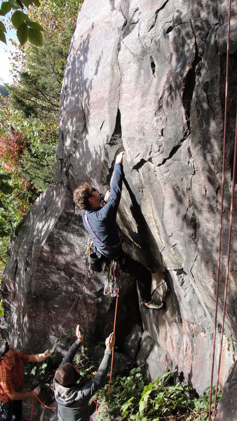 Stewart of the HWDAMF working through the beginning boulder problem.