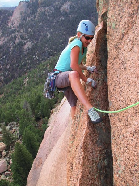 Kat A. follows the Standard Route (5.11a) at Sunshine Wall.