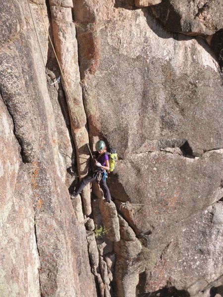 "Jenny Antin on P2 of King Me, just before the traverse left under the ""nose"" feature."