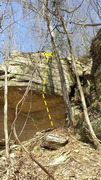 The short roof followed by a steep slab on the right side of the cave.