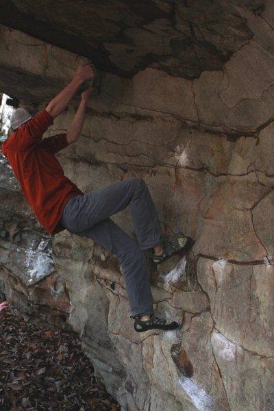 Climbing through the crux roof sequence