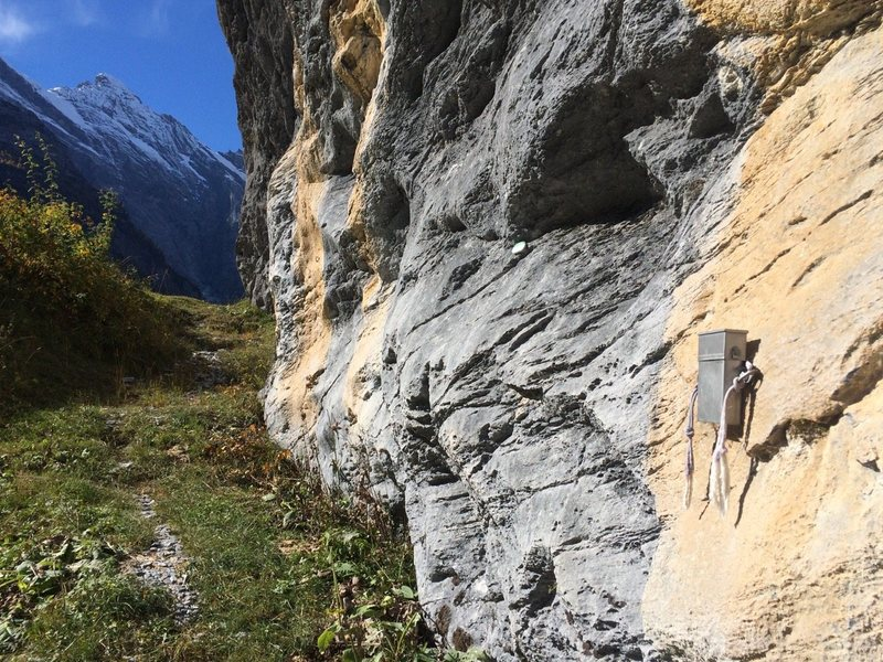 A metal box contains a laminated route sheet and topo for all 31 classic climbs in the area. We found at least a few other routes in between the listed ones of the sheet. Many of the routes have markers at their base.