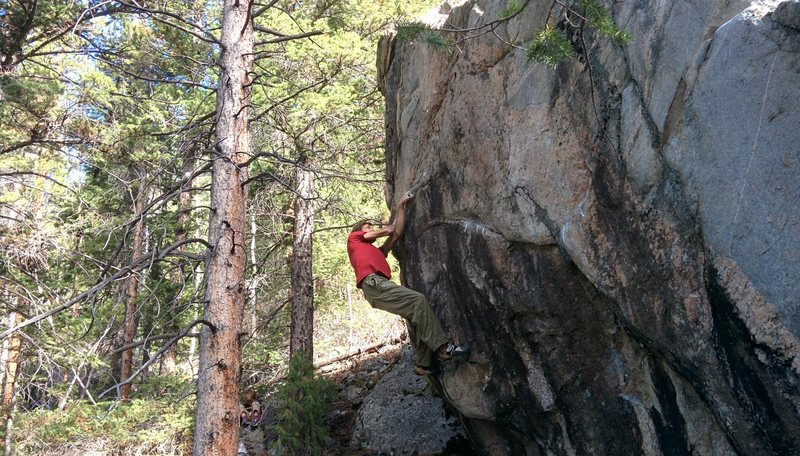 Ben Scott climbing on the Hornet's Nest.