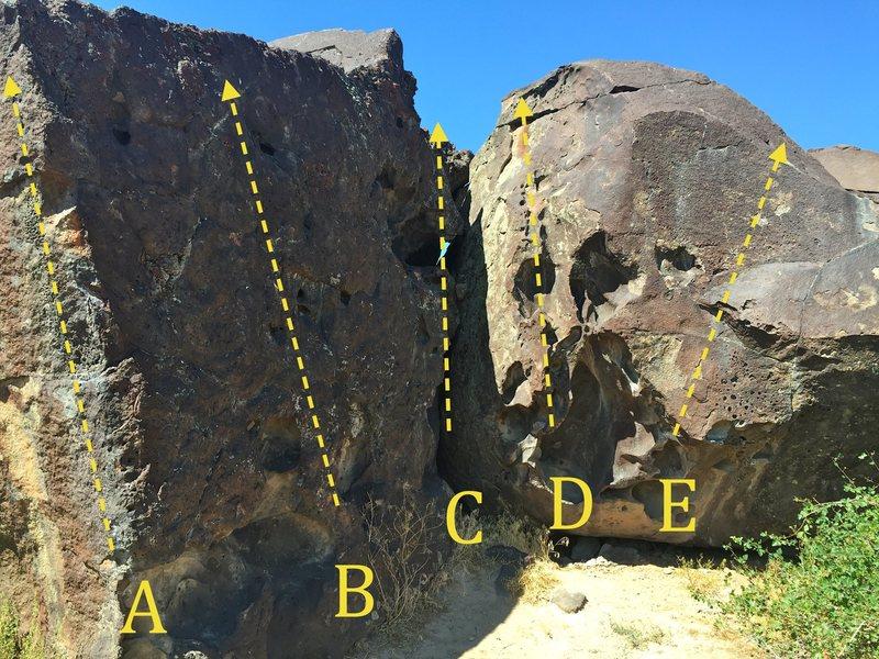 Cube (East Face):<br> A) Cube Arete V1<br> B) Cube Descent V0<br> C) Dihedral Downclimb V0<br> D) Easy Huecos V1<br> E) Snapper V4