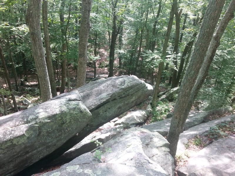 Large and obvious prow shaped boulder on the top of the talus area.