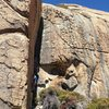 """The route goes up the obvious arete to the left of the climber on """"Space Cowboy"""" 12a"""