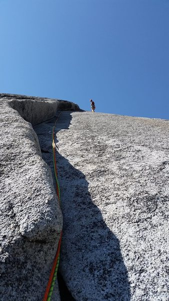 At the anchors of pitch 1 on West Country, Tuolumne Meadows.