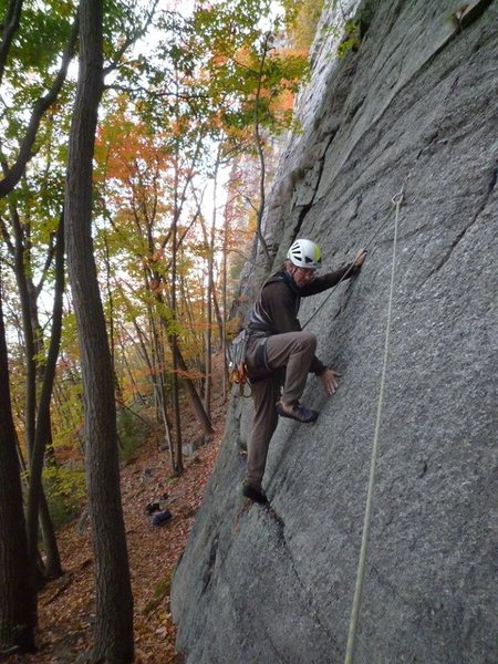 The crux start on the slab.  I needed a bit of help from a stick to get the cam in overhead to protect these moves.