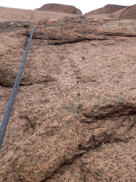 The crux area and the one bolt (right of the rope).