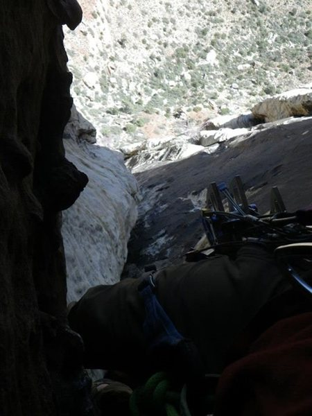 Looking down from the surprisingly secure crux roof