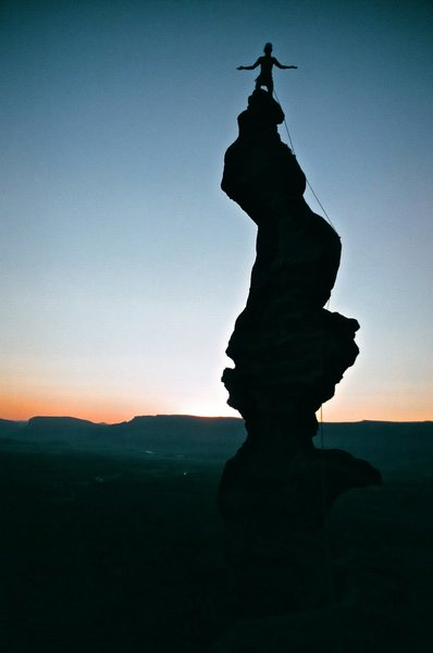 Rock Climbing Photo: Bailey Crawford summits as the sun sets.