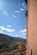 Rock Climbing Photo: Moving his foot up the green Camalot size crack.