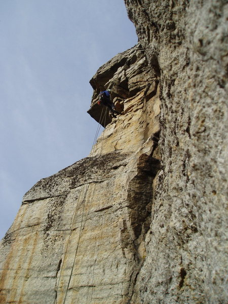 Rapping off Sound and Fury - When climbing up, don't underestimate the flake/crack just below and right of Alan's foot.