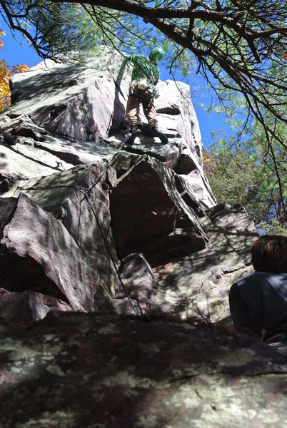 "Doug Hemken pulling the crux of ""Bloody Shin"" on his on-sight lead.  This is a pretty stiff ""5.7 move""."
