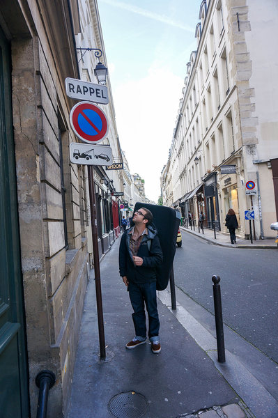 Rock Climbing Photo: Pete walking the streets of Paris crashpad en tow