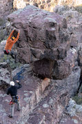 Rock Climbing Photo: Manny R. climbs the boulder marking the top of the...