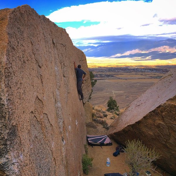 Harrison Eberlin takes in the view on the Hall of the Mountain Queen boulder