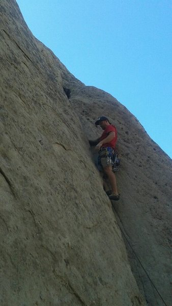 Leading an easy trad route.