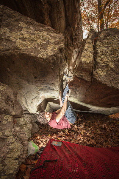 Carlin working on his double foot cams across the low roof of Earth Wyrm.<br> <br> Photo by Diego Correal