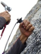 Rock Climbing Photo: Close-up of Brian Bennett drilling the second bolt...