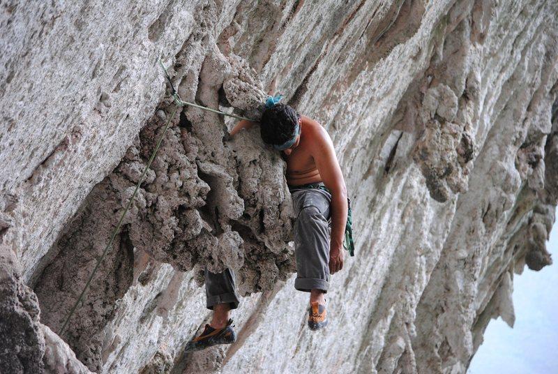 Joel Heriberto Guadarrama resting on La Gripa (5.12c) Cueva del Oso.<br> <br> Photo: Mark Grundon