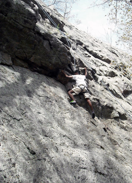 Climber on Overhang Notch (5.5).