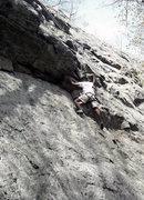 Climber on Overhang Notch (5.5).