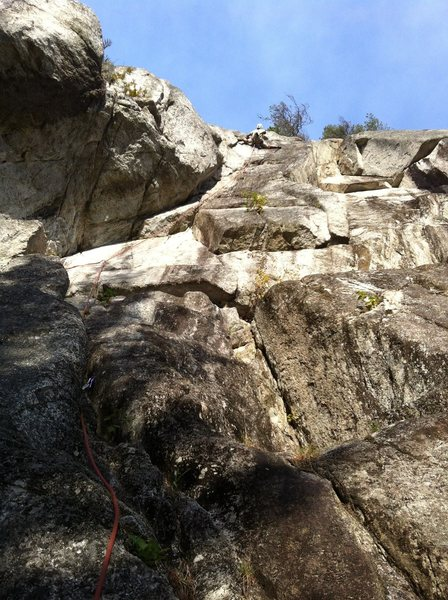 Jonas crushing through the bolted crux. Awesome horizontal crack somewhere around the crux is neat.