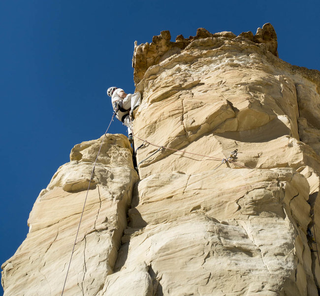 Me, grooming my nerves before yarding on the caprock. Great free finish to this climb! Photo: Roy Suggett