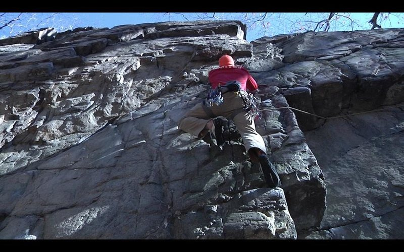Ryan Webster traversing left out of the roof, about to enter the crux.
