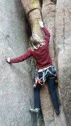 Erin cleaning the route.  There were a lot of peanut rocks in the crack.