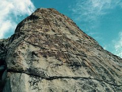 Rock Climbing Photo: Knob Job ascends the left side of the tower. Chick...