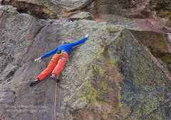 Molly Mitchell climbing the technical face to the top. <br /> <br />Photo by Craig Hoffman.