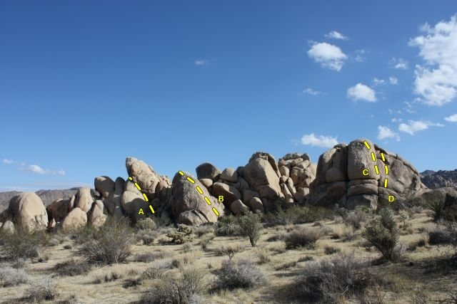 The north end of Grain Central Station, Joshua Tree NP<br> <br> A. Staircase Crack (5.4)<br> B. B.M.T.C. Leader (5.7 R)<br> C. Snoops (5.6)<br> D. Dancing on Dimes (5.7)