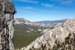 Ben Ditto climbs out the 4th pitch crux of High Times on Drug Dome, Tuolumne Meadows, CA <br /> <br />Katie Lambert can be seen belaying at the base of the pitch. <br /> <br />photo by Owen Bissell