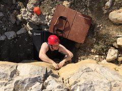 Ethan climbs Wonton at CAB boulder.