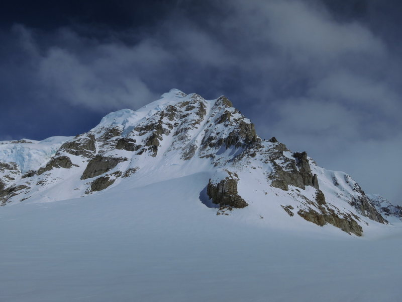 Head on view of the SW ridge from the main Kahiltna glacier. False summit cornice is clearly visible. Main summit is just to the left.