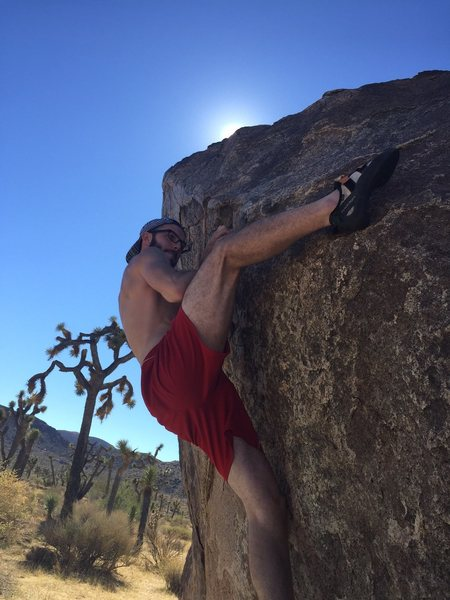 K. Adams using a high foot on Fade (V3) at the Bighorn Boulders, J.Tree