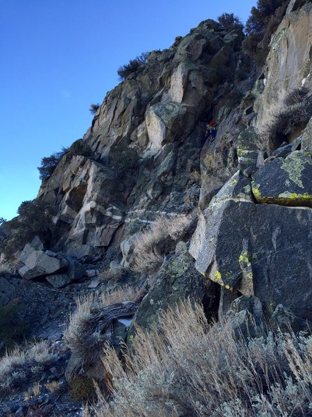 One of the 5th class diorite downclimbs on the descent. Photo: Johnny K