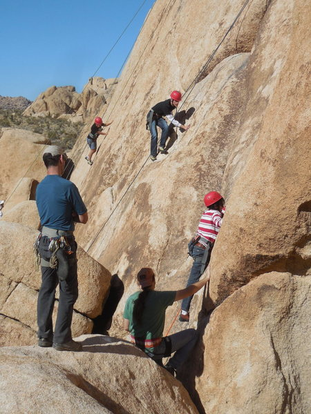 A Braille Institute climber on Bakersfield Bomb at Hodgepodge Rock.