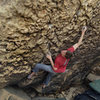 This is Zach climbing yet another boulder in a lost canyon someplace.  Cool looking rock, huh?