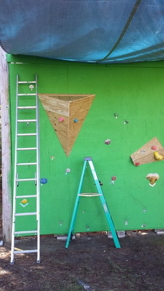 Had to add a mega volume. Used scrap and left over wood. Got the idea from one of the volumes in my old gym. This made the flat wall come alive with some awesome new routes.