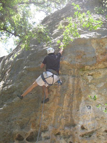 Jordan starting crux sequence at first bolt.