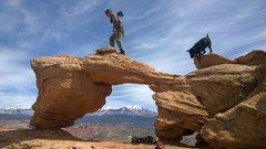 Rock Climbing Photo: Natural Bridge south of Moab framing Mt Tukuhnikiv...