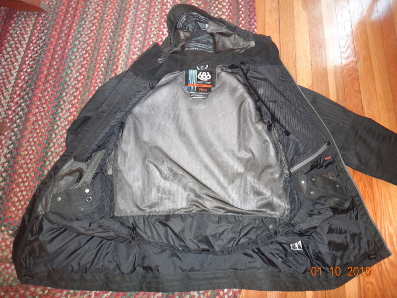 Interior of 686 Plexus Hydra Shell. Pockets, Powder skirt. Powder skirt can clip into belt loops of pants.