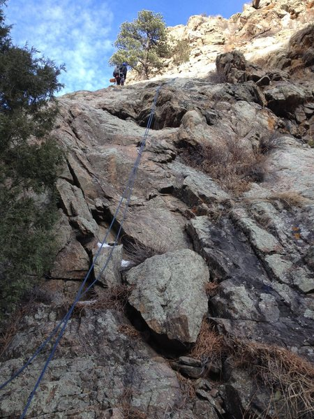 Rock Climbing Photo: The route with a rope on it and Greg Hand bolting ...