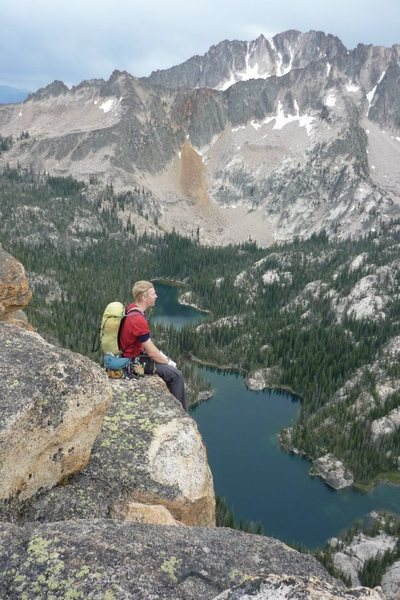 Taking in the view after climbing The Mountaineers Route on the Elephants Perch in the Sawtooth Mountains, Idaho.