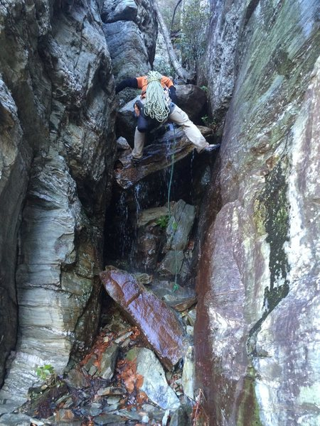 Crux of the Approach Gully,  It is has been raining. It is a slight waterfall.